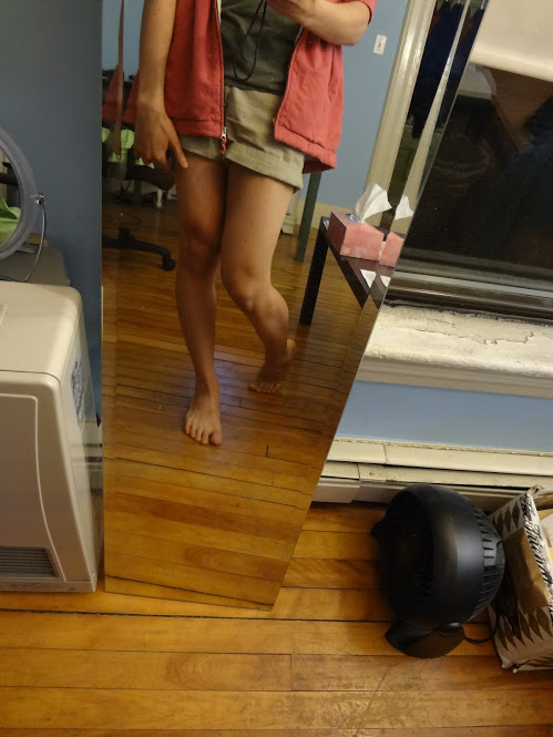 A mirror selfie showing Marina's shaven legs